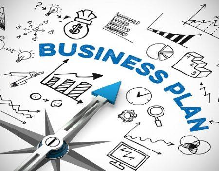 Business Plan mit Kompass und vielen Symbolen und Diagrammen